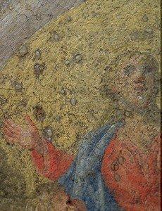 Macchie di cera sulla superficie di un dipinto